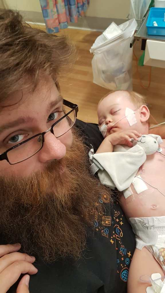 Baby with her Dad after surgery