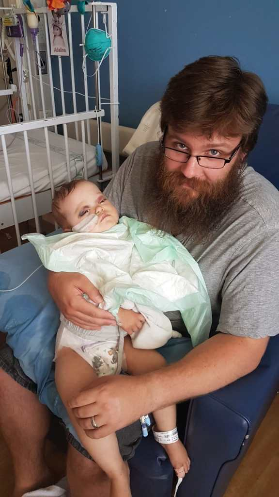 Dad and baby in hospital